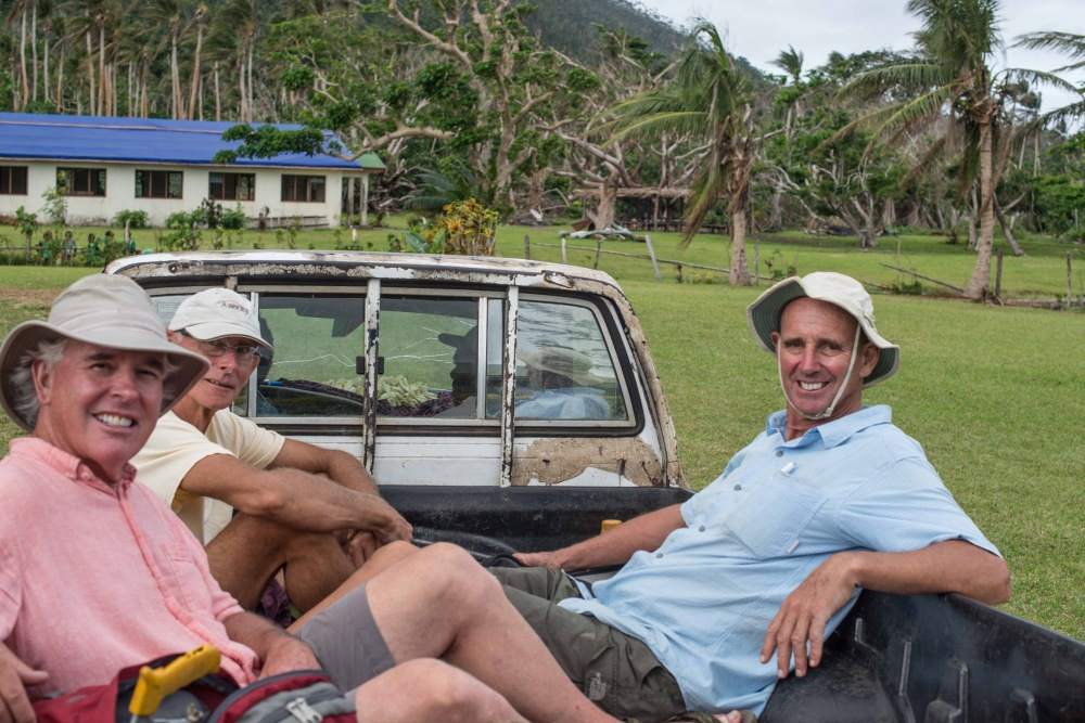 The boys returning to the beach for a well-earned cold Tusker beer.