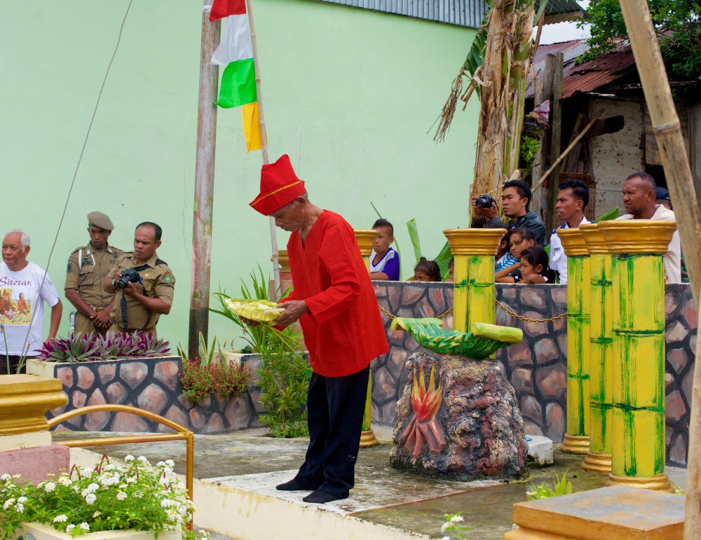 The Village Elder blesses our boats during a solemn ceremony.
